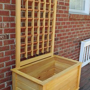 Planter with copper tubing trellis
